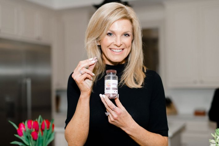 Tanya Foster holding CocoaVia supplement capsule