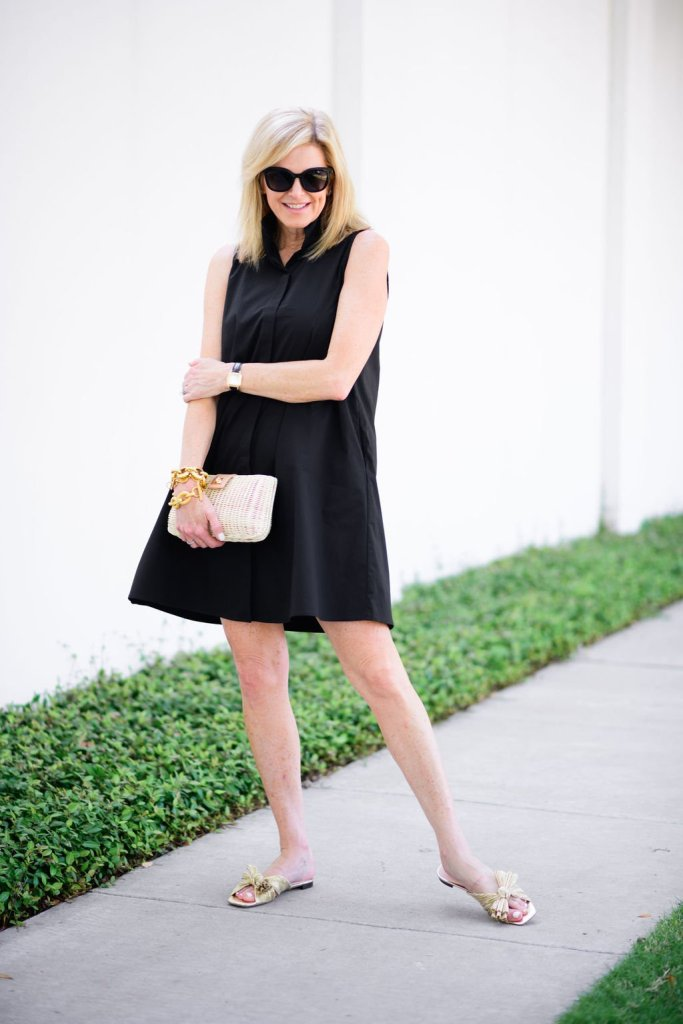 Tanya Foster wearing Tuckernuck black dress for summer with tuckernuck clutch
