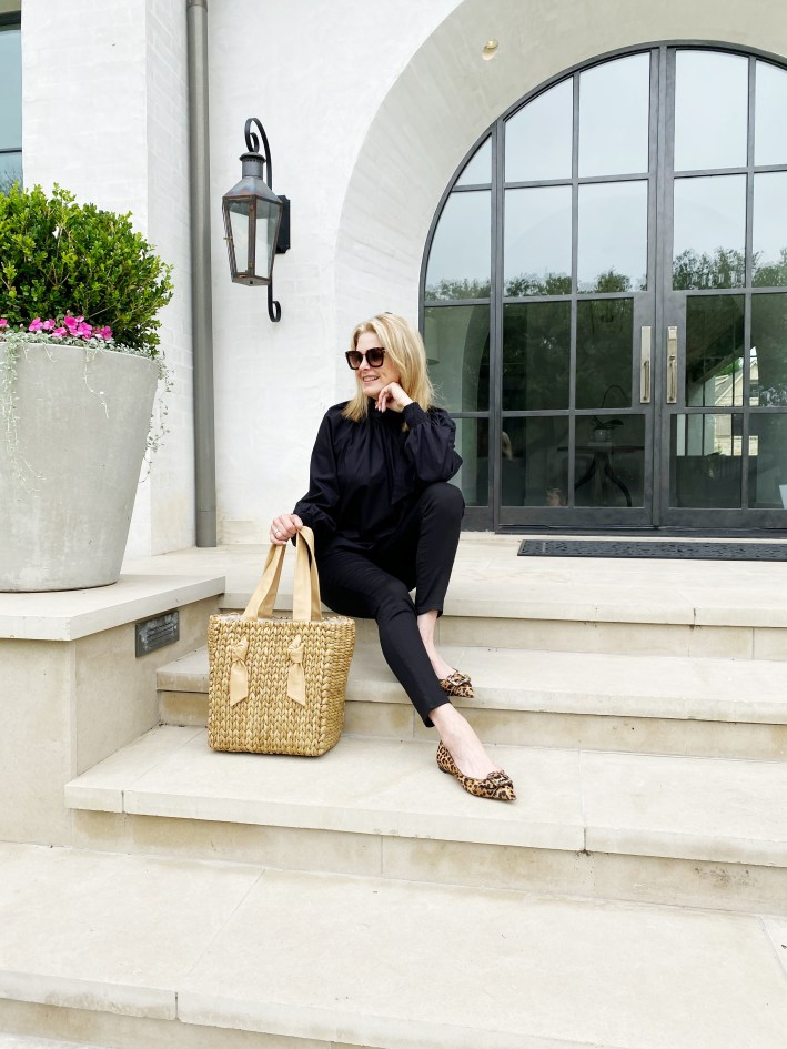 Tanya Foster in black and neutral top shop black blouse black mott and bow jeans sam edelman flats shopbop purse and tom ford sunglasses
