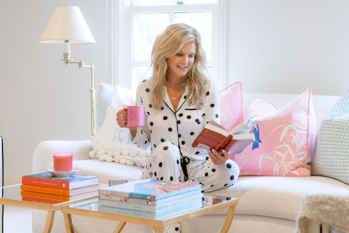 TAnya Foster in soma cool night pajamas reading a book and holding a coffee mug