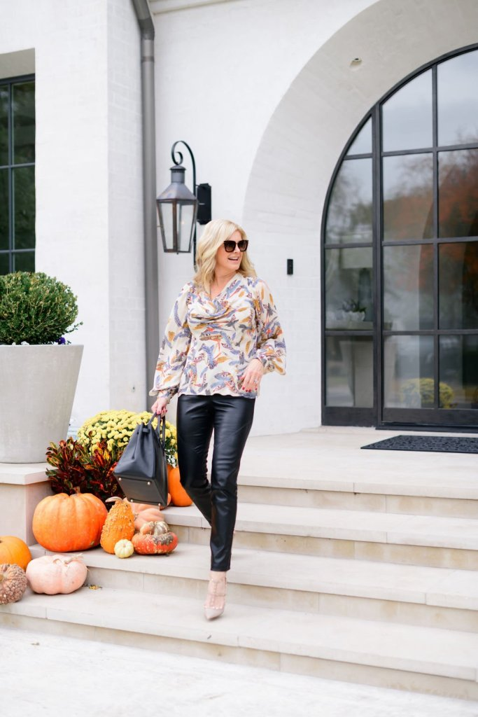 tanya foster wearing ala von auersberg blouse faux leather pants and heels