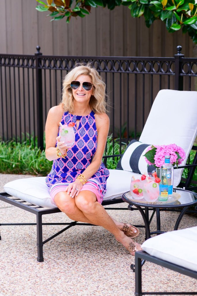 Tanya Foster holding refreshing summer cocktail