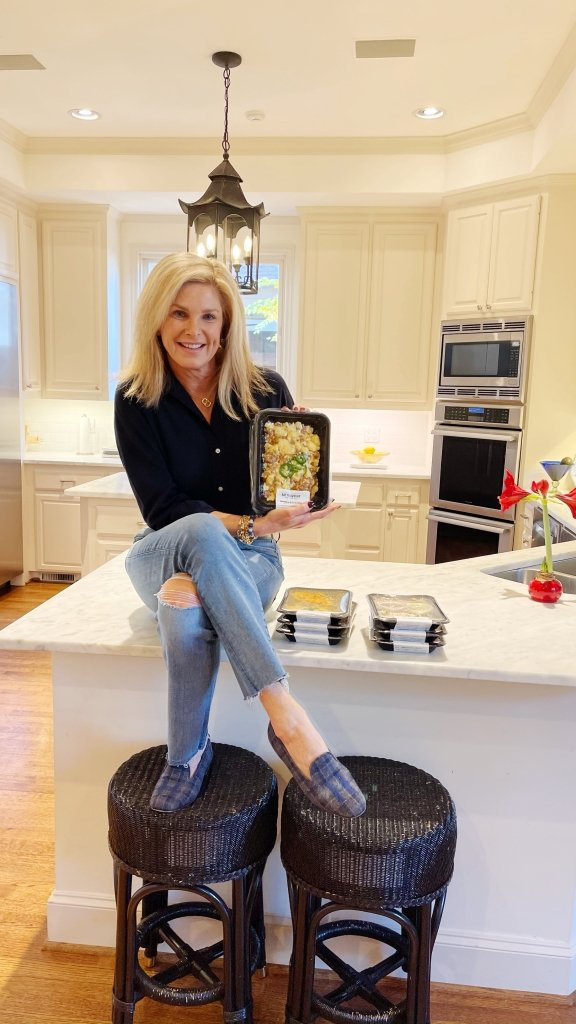 Tanya Foster holding eat to evolve packaged meal