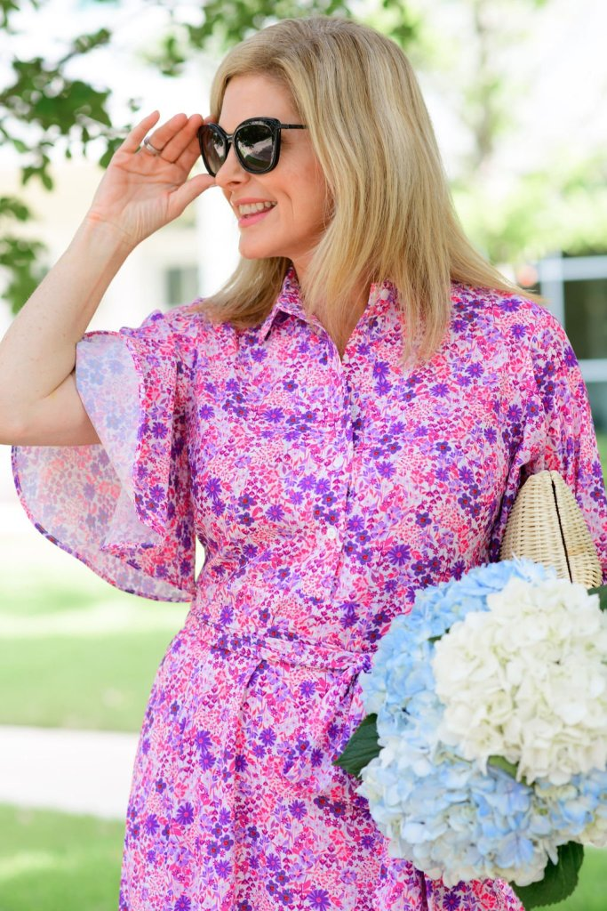 Tanya Foster in Tuckernuck pink floral betty dress holding flowers