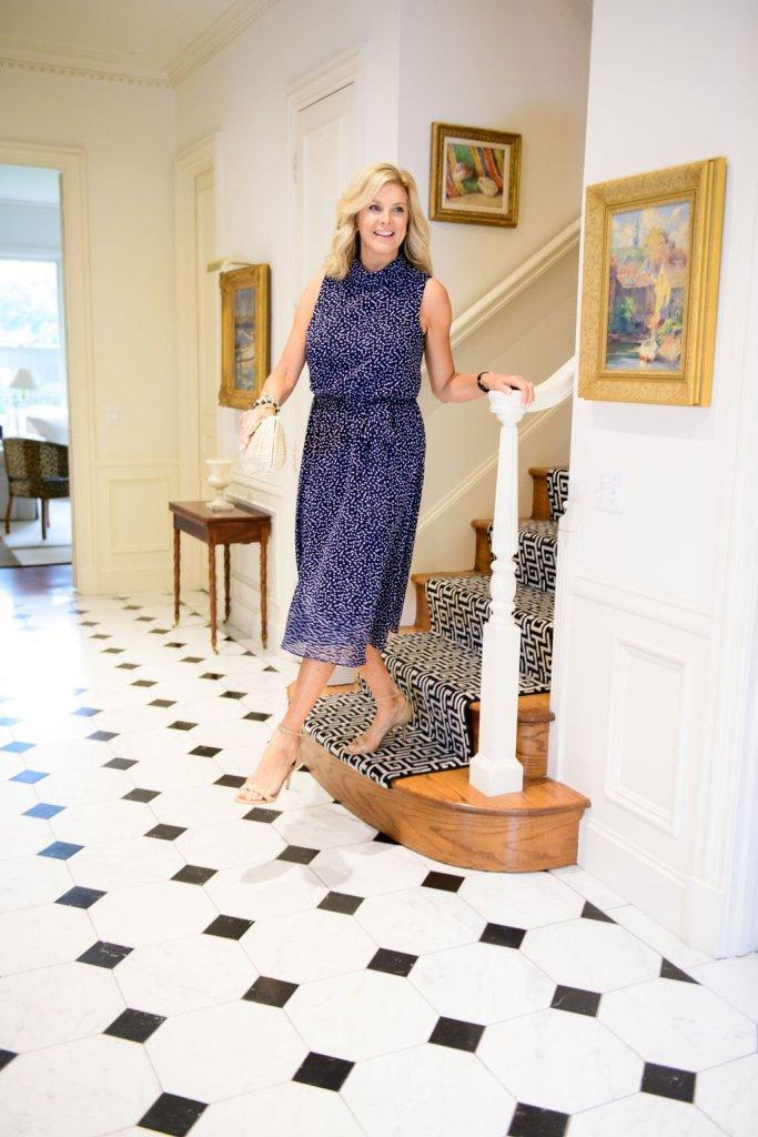 tanya foster walking down the steps in harper rose confetti print blouson midi dress