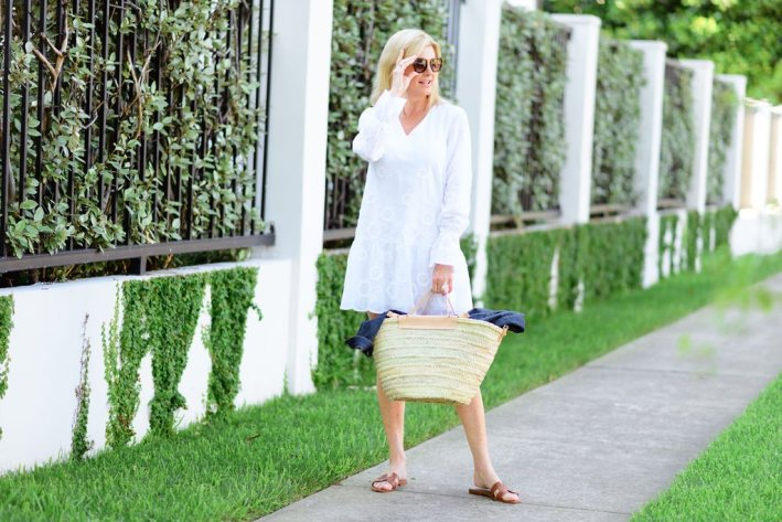 Tanya Foster in white sail to sable dress with hermes oran sandals and mango straw bag