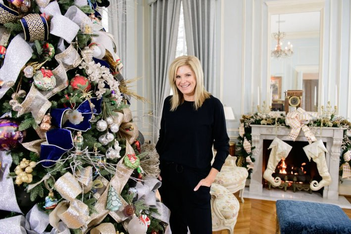 Tanya with Hello Holidays ribbon on tree