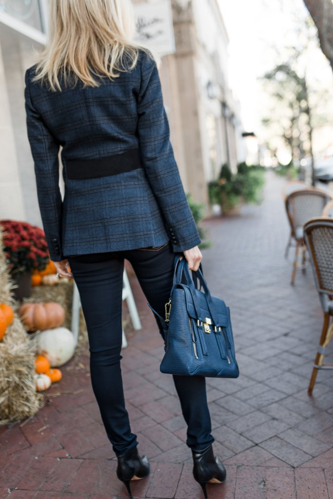 Dress up your premium denim look with a Veronica Beard blazer, black cashmere turtleneck and black booties
