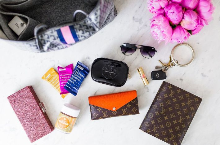 Sharing 5 bags that are worth the price and what's in my bag on TanyaFoster.com | 5 Best Designer Bags to Invest in and What's in my Bag by popular Dallas fashion blogger, Tanya Foster: image of the inside of a designer tote with a Goyard Saint Louis PM Bag Insert Organizer, Louis Vuitton wallet, sunglasses, and RX Bars.