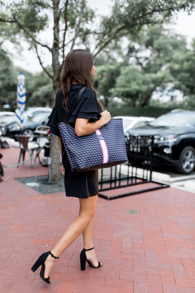 Millennial style featuring a black dress and black heels with Barrington Gifts tote
