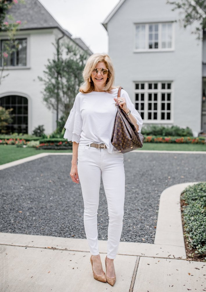 tanya foster in all white with a hermes belt and louis vuitton bag