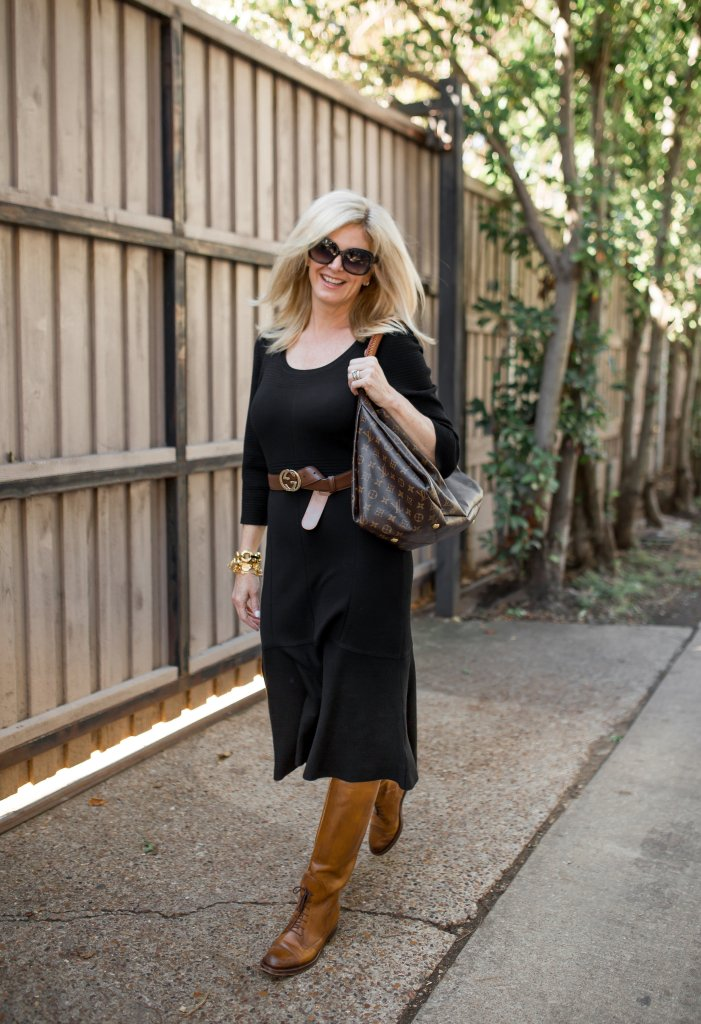 Soft Surroundings black sweater dress with brown riding boots from Cole Haan
