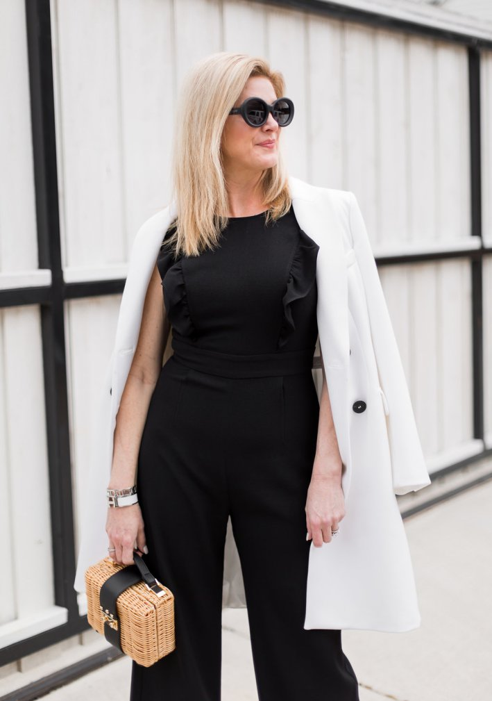 Charles Henry Black Jumpsuit, Zara White Coat, Free People Wicker Basket Purse, Quay Sunglasses