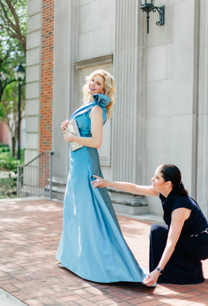 Patti Flowers Designs Mother of the Bride Dress featured by top US fashion blogger, Tanya Foster: image of a woman wearing a Patti Flowers blue one shoulder gown