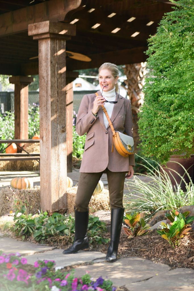 Tanya Foster wearing Tuckernuck plaid blazer and olive suede pants with avara turtleneck sweater gucci sunglasses and crossbody bag and riding boots