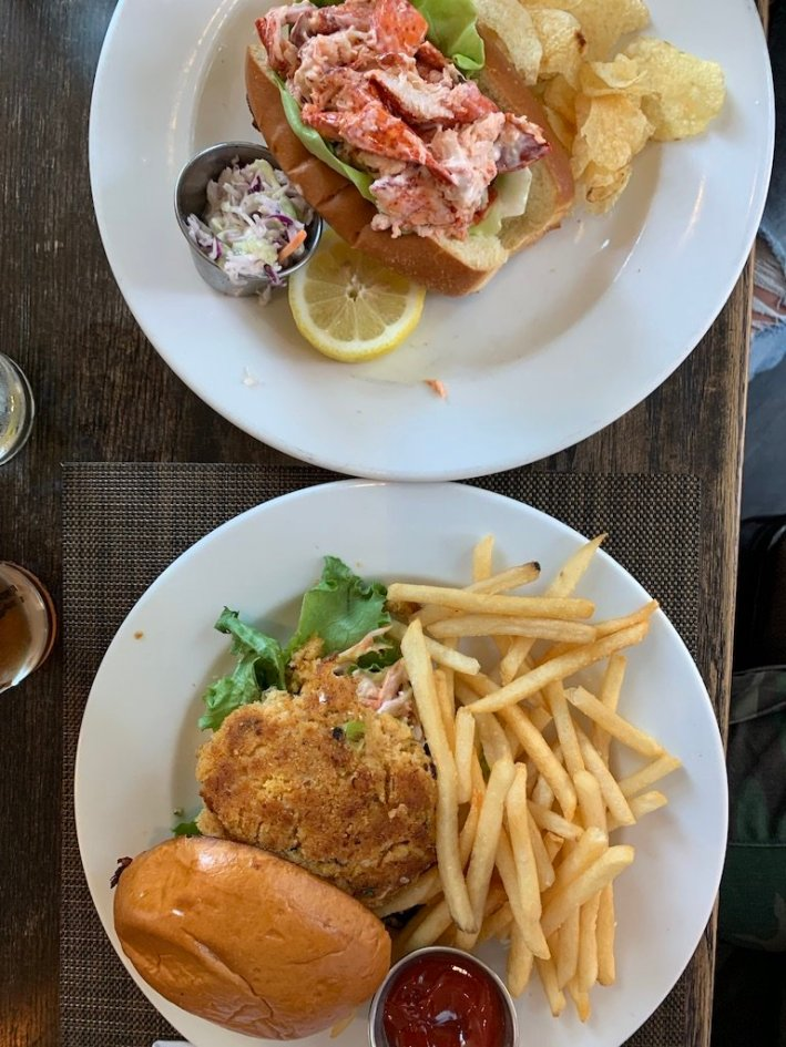 Tanya Foster visits Boston and shares her recommendations | Destination: Boston, Massachusetts Travel Guide by popular Dallas travel blogger, Tanya Foster: image of some lobster rolls and french fries.
