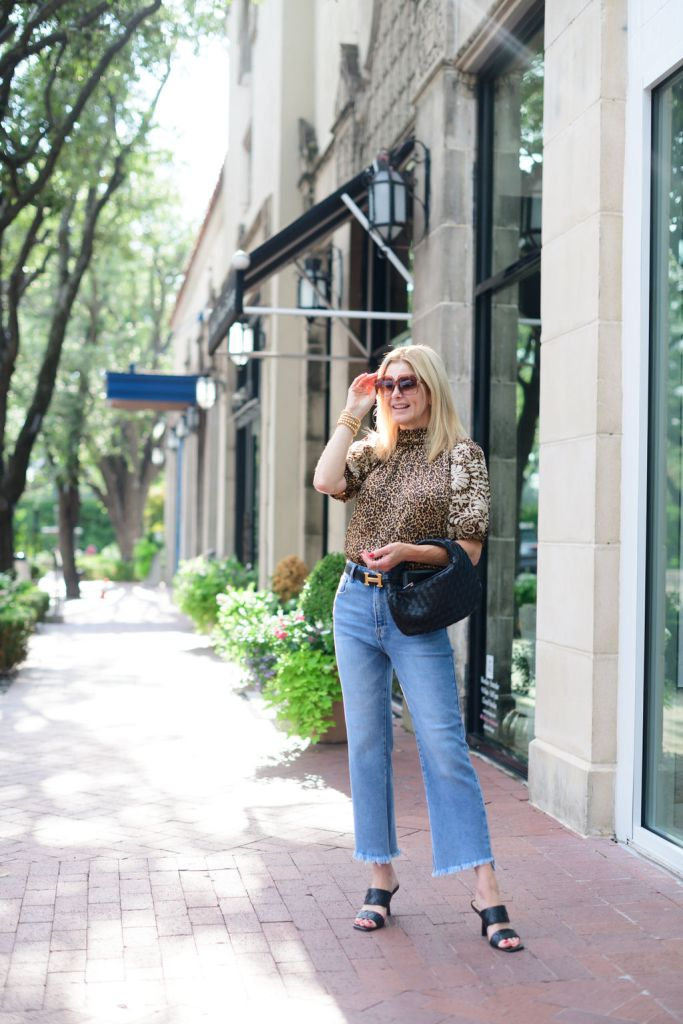 TAnya foster wearing animal print avara top and jeans