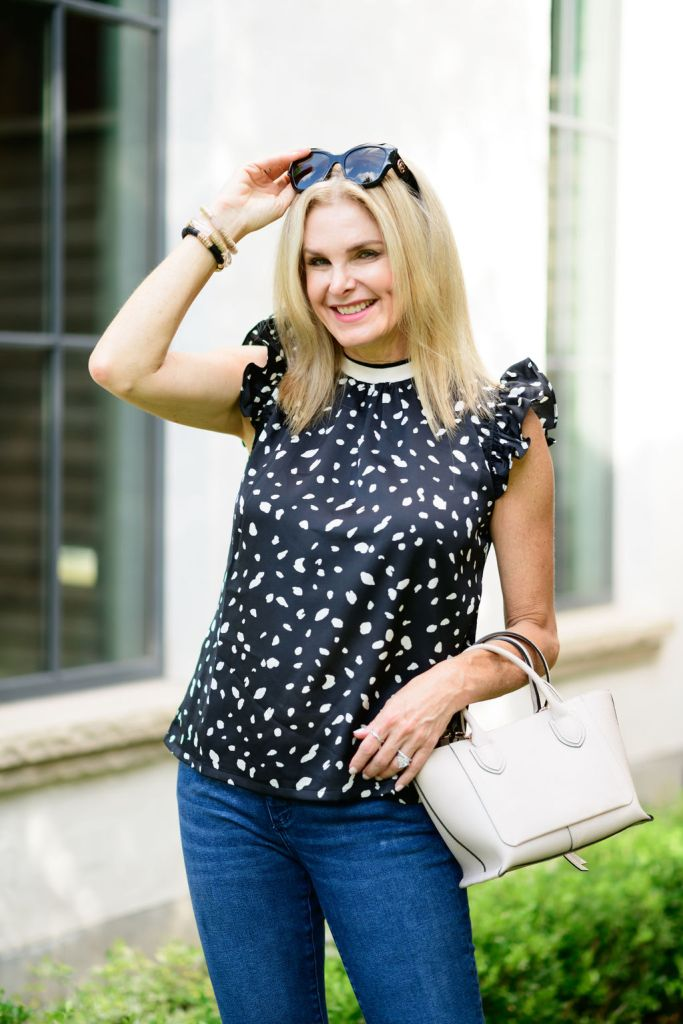 Tanya Foster wearing Avara blouse and ann taylor jeans holding longchamp tote