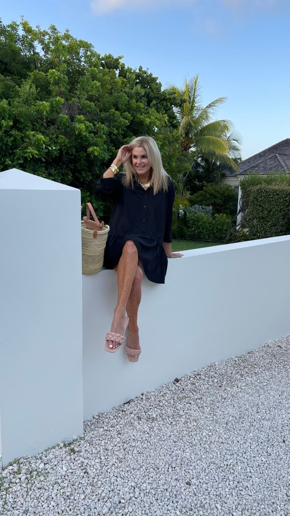 Tanya Foster wearing black avara dress and slide sandals with Nest jewelry
