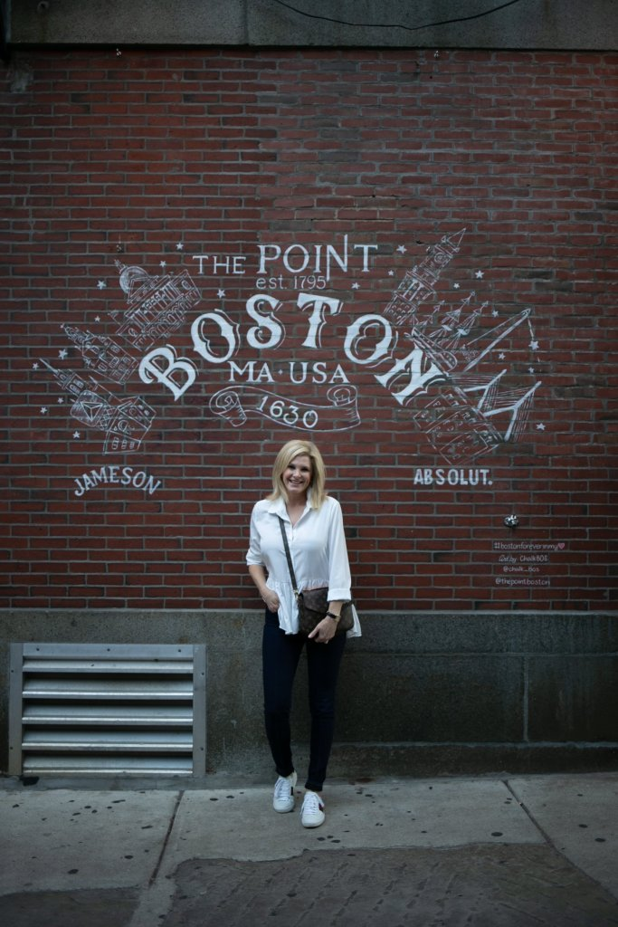 Tanya Foster visits Boston and shares her recommendations | Destination: Boston, Massachusetts Travel Guide by popular Dallas travel blogger, Tanya Foster: image of woman standing in front of The Point in Boston, MA.