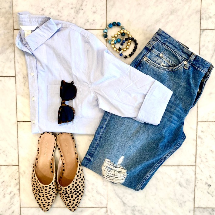 flat lay of H&M button up, denim, madewell mules, hazen & co bracelets and tuckernuck sunglasses