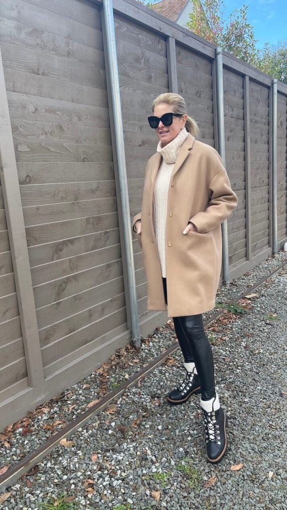 tanya foster in lou & grey sweater faux leather leggings camel coat and shearling hiking boots