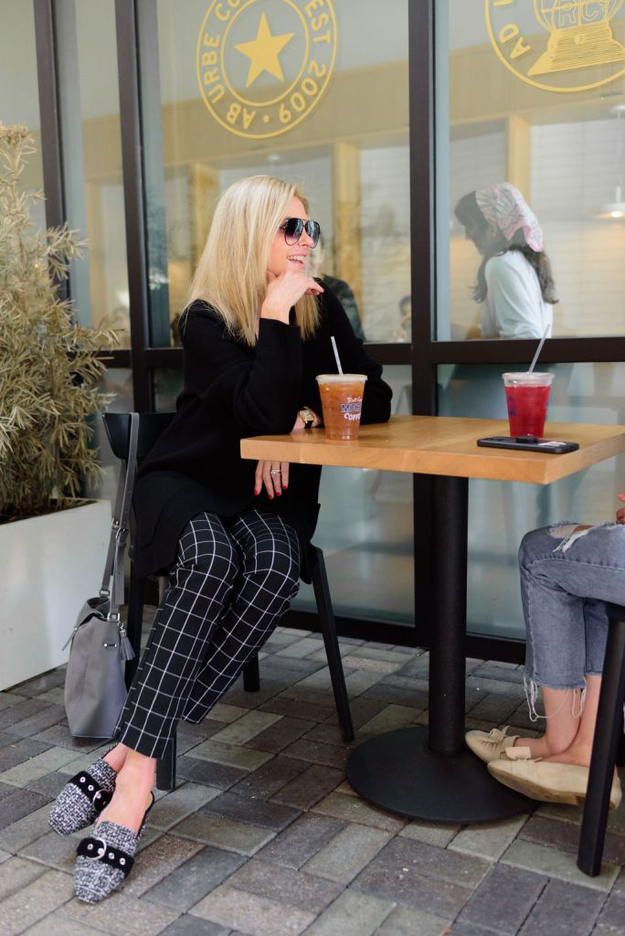 Tanya Foster on a coffee date in plaid pants, cardigan blazer, and slides