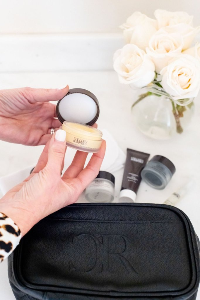 Tanya Foster holding Colleen Rothschild radiant cleansing balm from the Discovery Kit