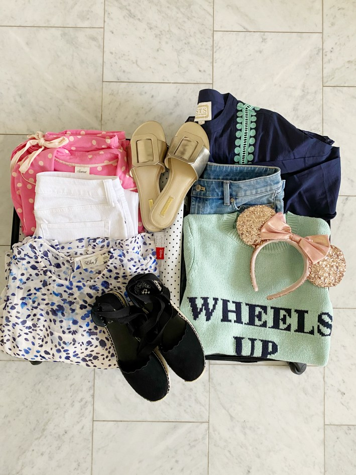 assortment of clothes for walt disney world and a disney cruise