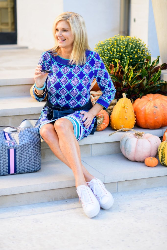 Tanya Foster in cabana life dress with jean jacket tied around waist and barrington bag with converse sneakers