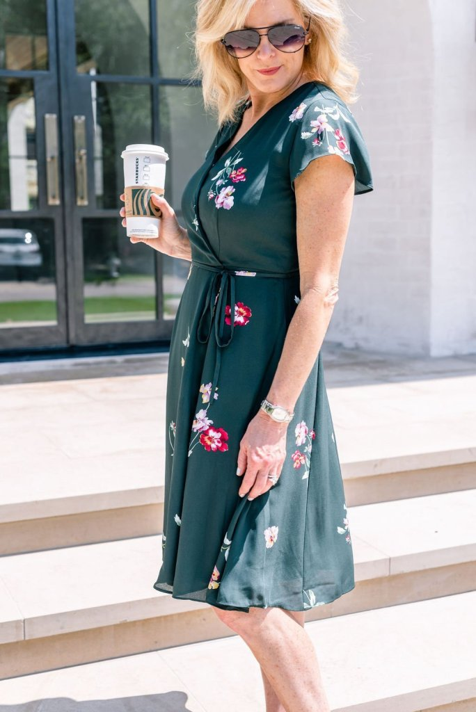 Fall Fashion from Friends of Ann Taylor Sale | Seasonal Style with Ann Taylor Fall 2019 by popular Texas fashion blogger, Tanya Foster: image of a woman standing outside on some stairs and wearing a Ann Taylor Floral Wrap Flare Dress.