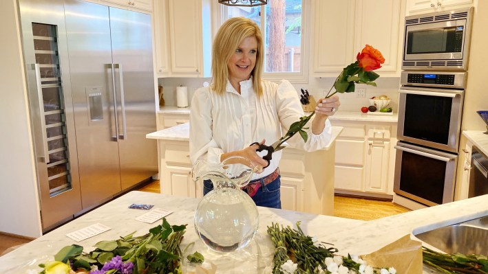 Tanya cutting flowers and putting them in a vase