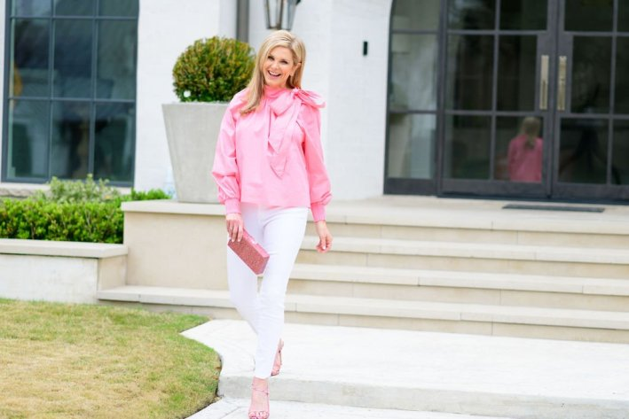 Tanya Foster in a pink topshop blouse and white jeans
