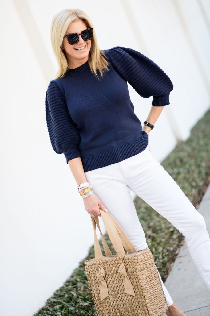 tanya foster wearing sail to sable puff sleeve sweater, white madewell skinny jeans, christian dior slide sandals and pamela munson bag with tuckernuck sunglasses