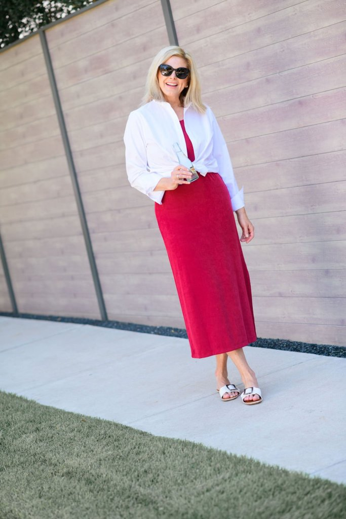 Tanya foster in chico's red dress and white dress shirt and m.gemi white slide sandals