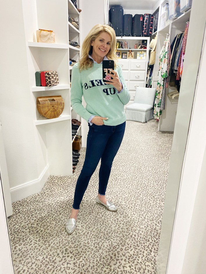 Tanya Foster wearing sail to sable sweater and jeans and mules