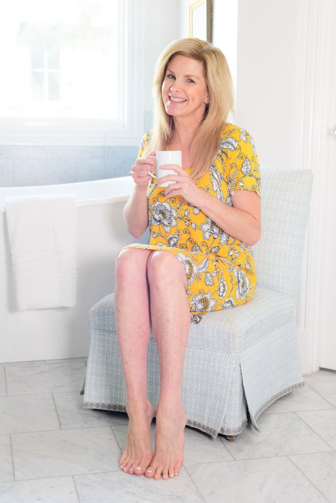 Tanya Foster sitting in a soma sleepshirt with coffee