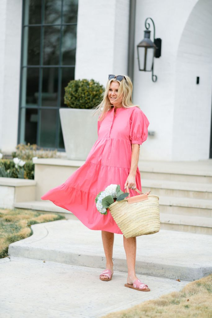 tanya foster wearing avara midi dress with a straw bag with flowers