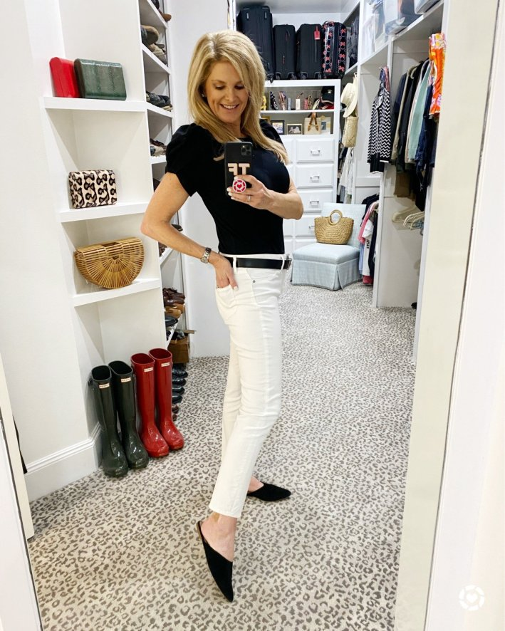 Tanya Foster standing in white jeans and black blouse