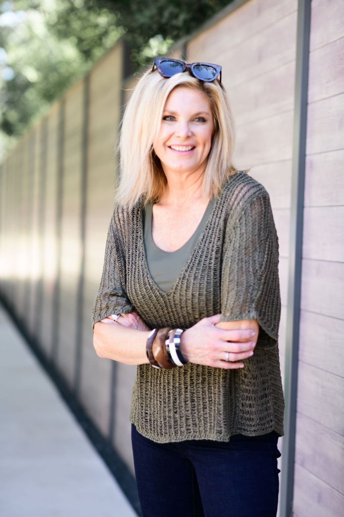 tanya foster in chico's black pants and v neck sweater and tank with black pants