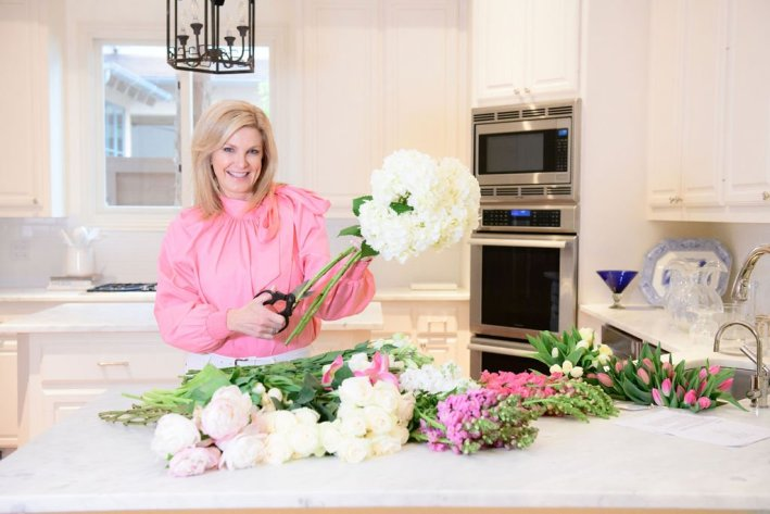 Tanya Foster with flower from the garden gate fun flower box