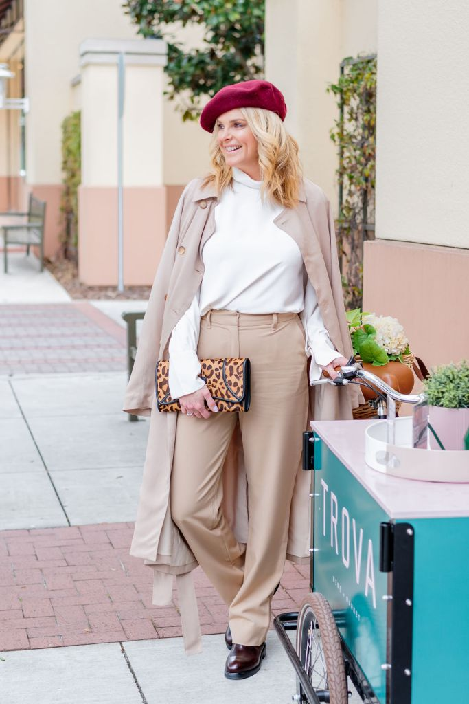 Tanya foster wearing billie the label blouse trousers and trench coat