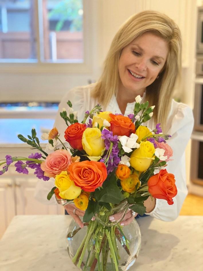 Tanya holding UrbanStems flower bouquet in vase