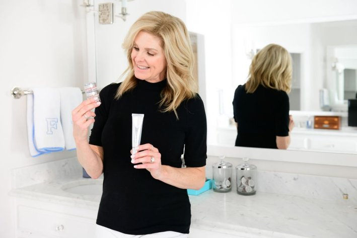 Tanya Foster holding Trinny London product