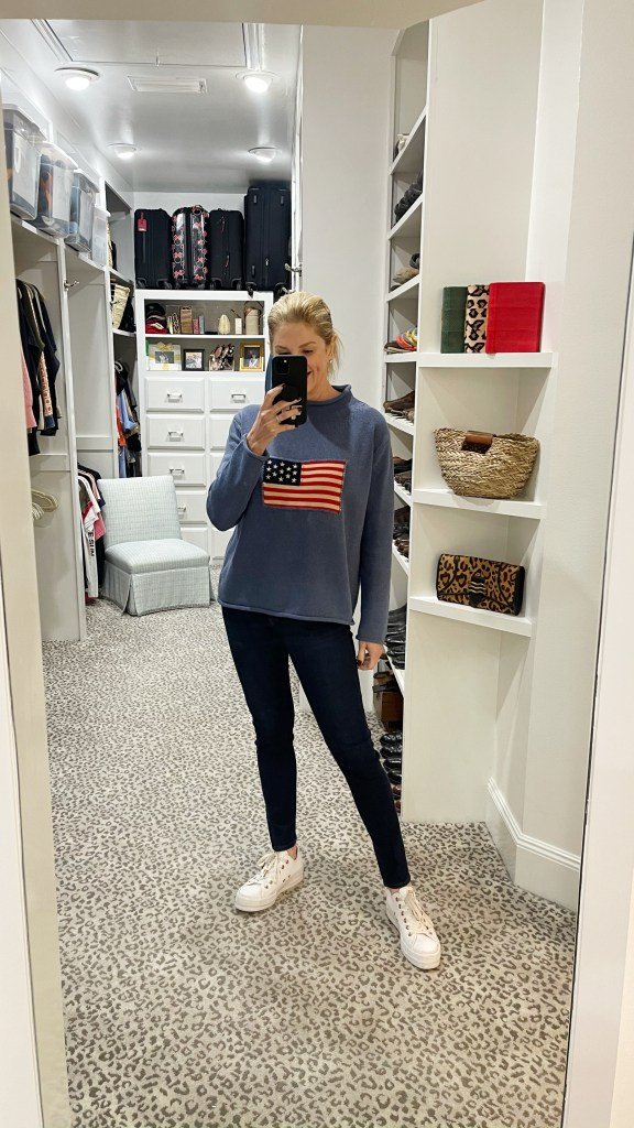 tanya foster wearing tuckernuck americana sweater with jeans and converse sneakers