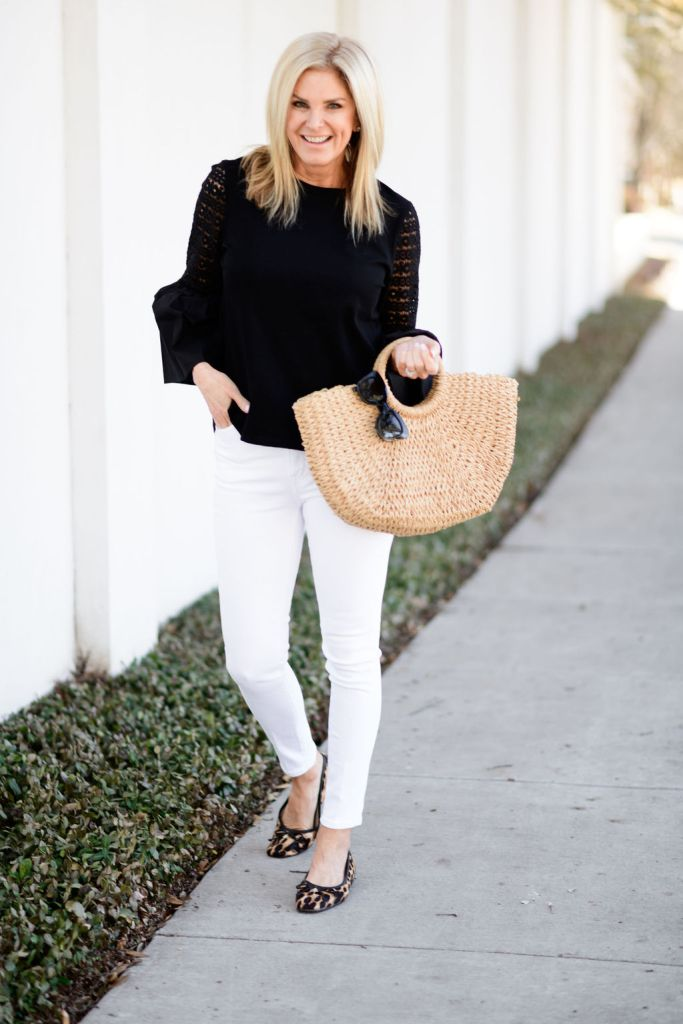 tanya foster wearing black blouse and white jeans