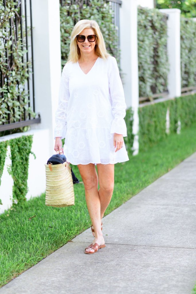 Tanya Foster in a white sail to sable dress with a beach tote