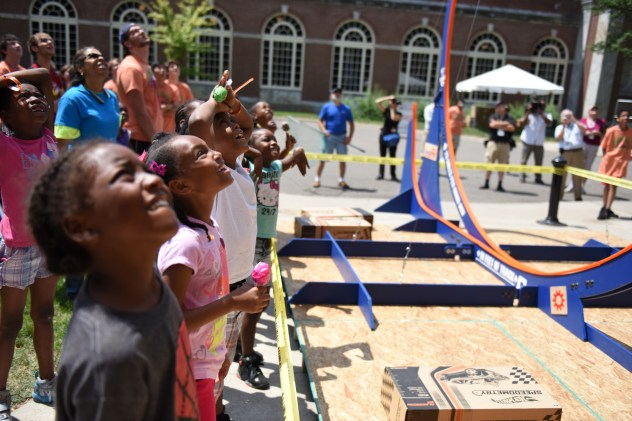 After building their cars from scrap materials Maker Faire attendees go head-to-head racing their cars down the track. Maker Faire Detroit attendees learn to make and tinker with robots of all sizes, scrap crafts, weird science projects and funny bicycles on the campus of The Henry Ford Museum Saturday, July 25, 2015. Hundreds of tinkerers, inventors, craftsmen and hackers will gather at ÒGreatest Show (and Tell) on EarthÓ at the hands-on Maker Faire Detroit this weekend, now in its sixth year. (Tanya Moutzalias | MLive Detroit)