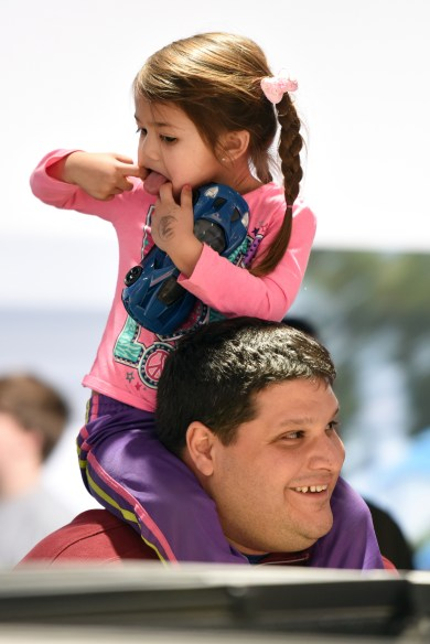 Ella Oddo, 3 of Macomb, makes a funny face while sitting on her father Tony's shoulders. Thousands of visitors attend the 2016 North American International Auto Show for 'family day' on Friday at Cobo Center in Detroit, Jan. 22, 2016. (Tanya Moutzalias | MLive Detroit)