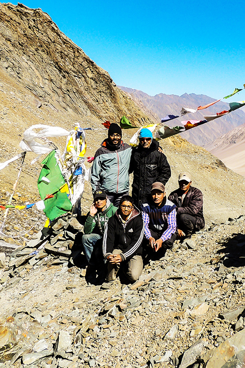 Proudly standing atop Bhabha Pass, with the men who made it happen - Negi Ji (in blue cap); seated Left to Right of the image - Param, Dhan Bahadur, Umesh, and Hari; Photo: Abhishek Kaushal